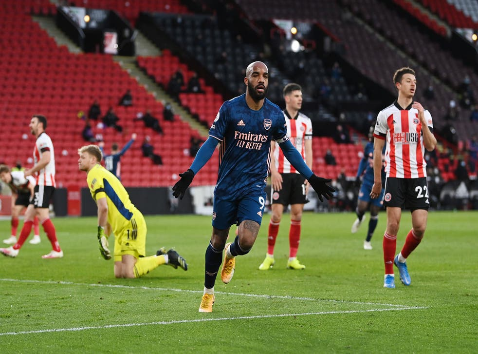 Alexandre Lacazette celebrates after opening the scoring
