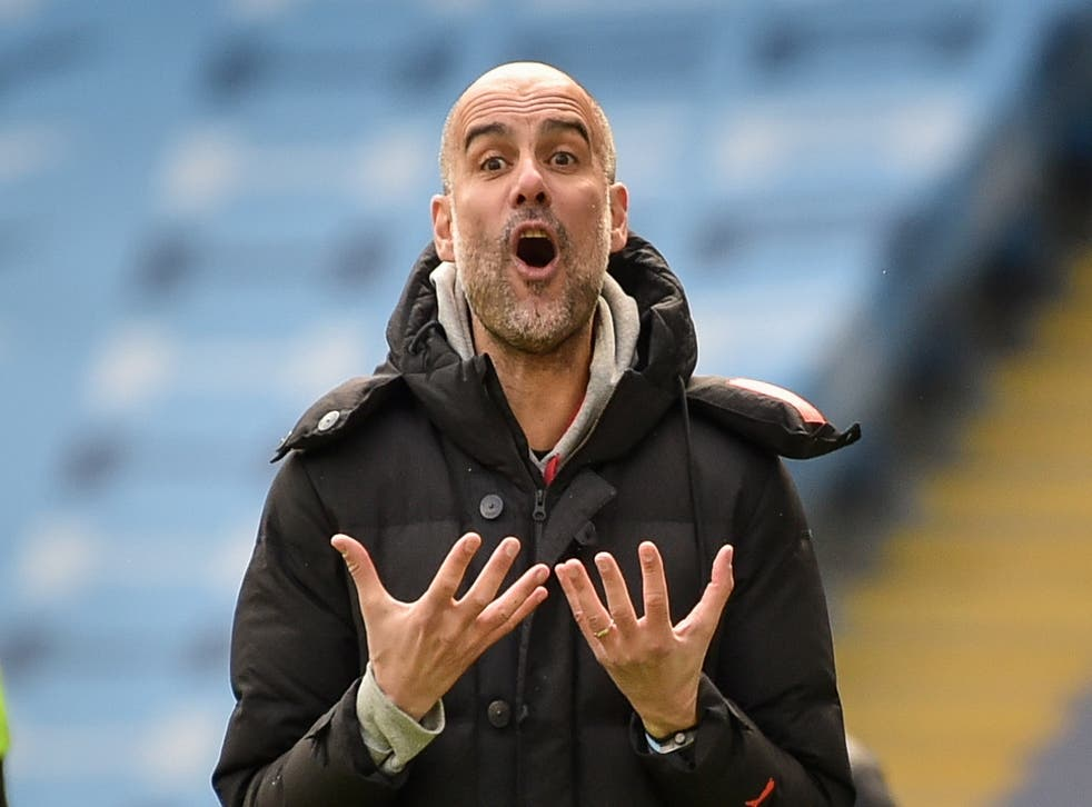 Pep Guardiola reacts during City's defeat by Leeds
