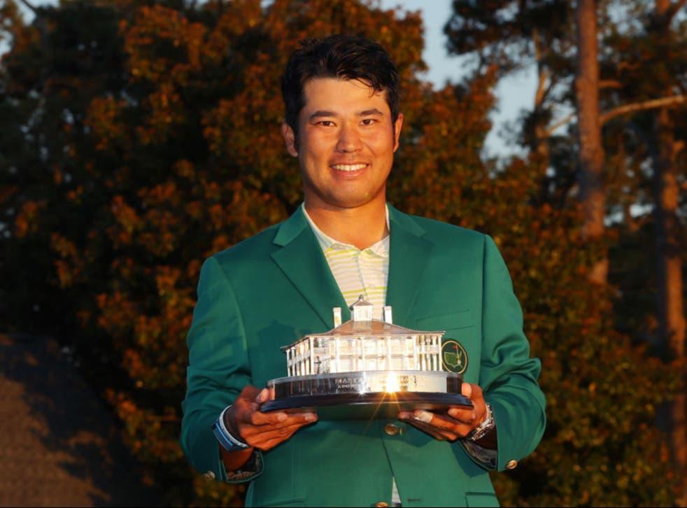 Hideki Matsuyama poses with the trophy