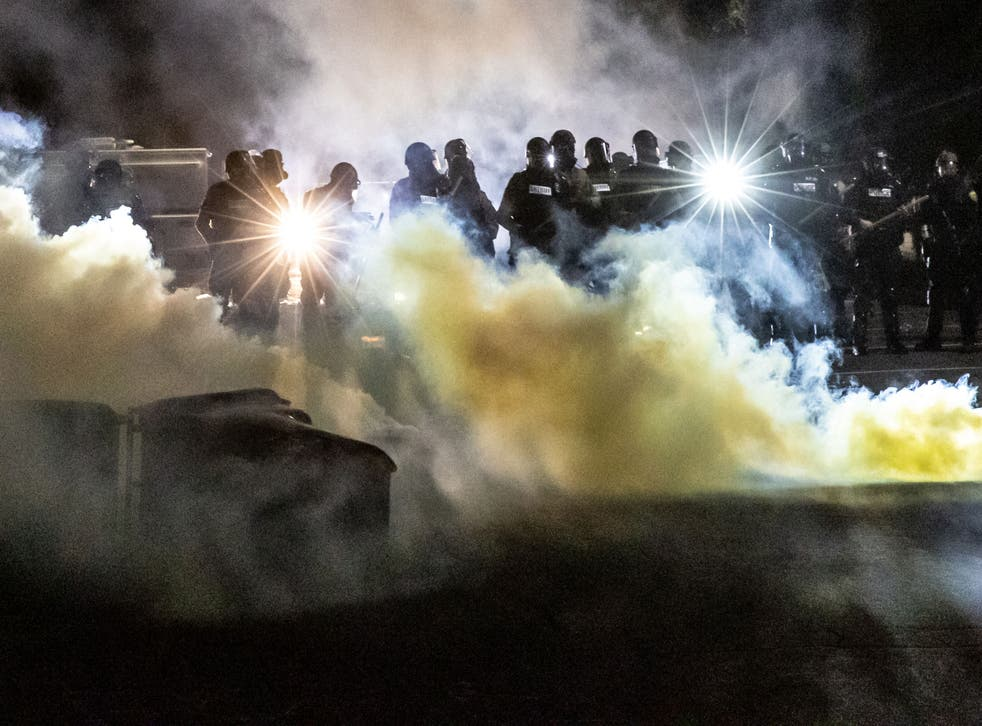 Police used tear gas to move people after protesters gathered at Brooklyn Center Police headquarters