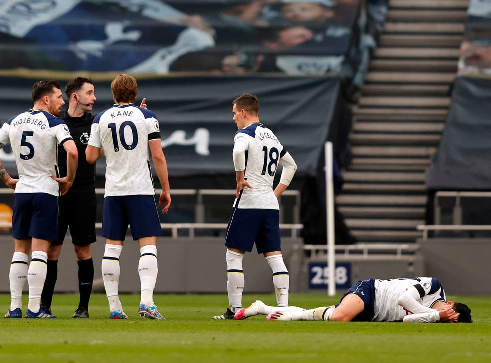 Son Heung-min (right) on the turf in Tottenham's loss to Manchester United