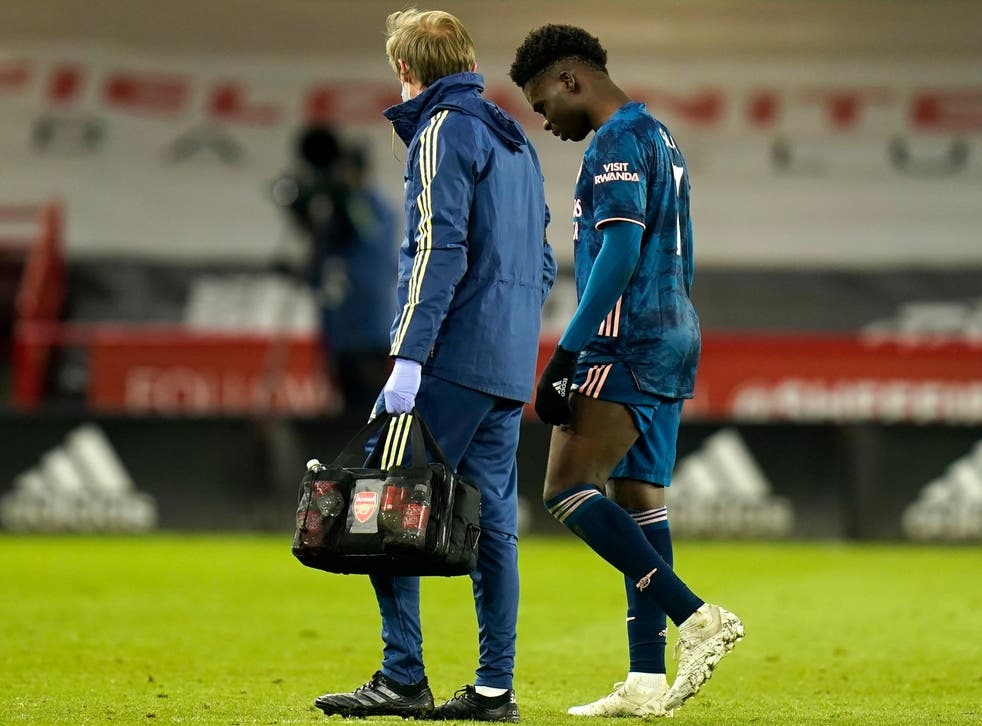 <p>Saka departed injured against the Blades</p>