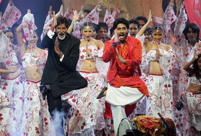<p>File image: Bollywood actors Amitabh Bachchan and his son Abhishek Bachchan perform on stage at the International Indian Film Academy Awards </p>