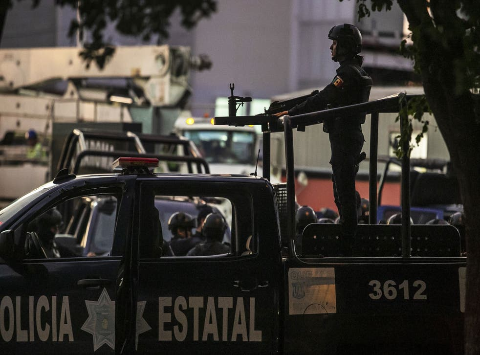 File image of Mexican police on patrol. National agencies said law enforcement had been called in to search for the missing truck