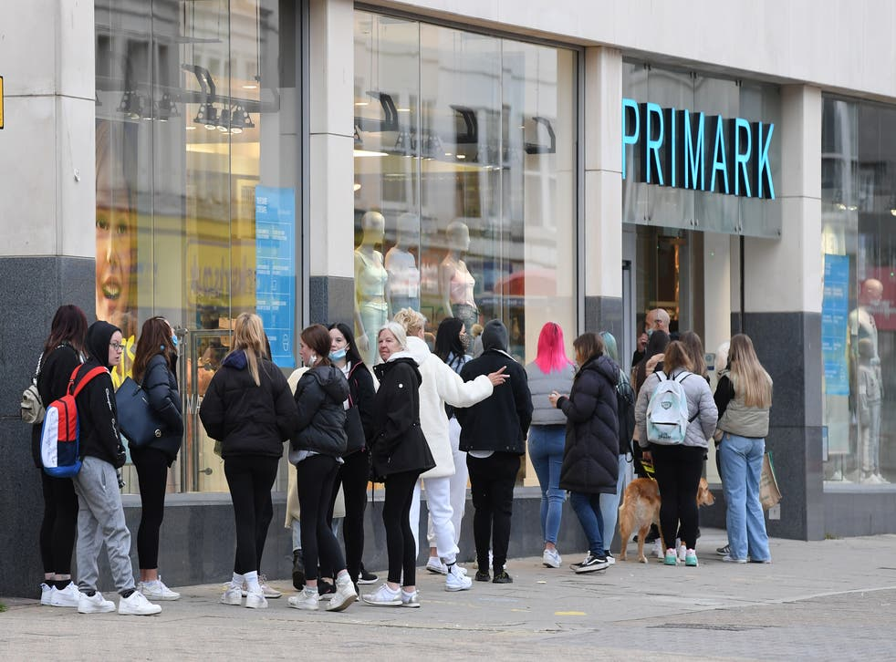 <p>People queuing outside Primark in Brighton as retail reopens</p>