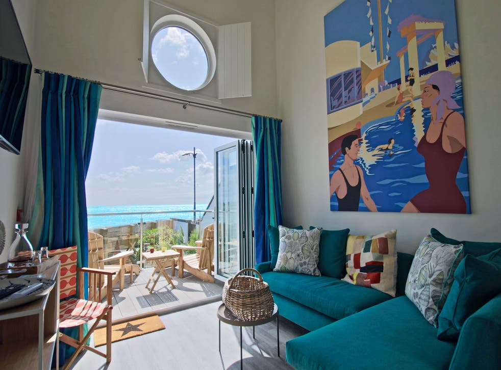 <p>Beachcroft Beach Hut Suites look out onto pebbly Felpham Beach in West Sussex</p>