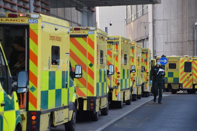 <p>Ambulances queue outside the Royal London Hospital in London in January</p>