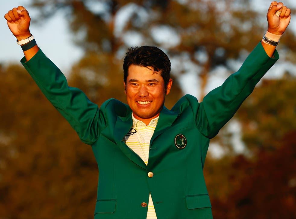 Hideki Matsuyama celebrates winning The Masters