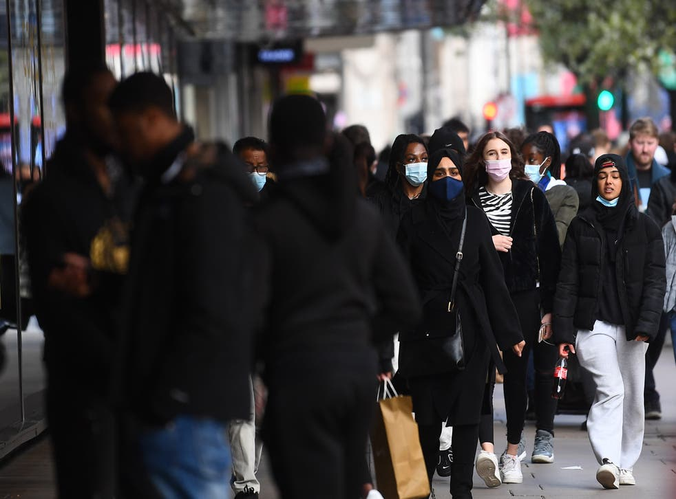 <p>Shoppers on Oxford Street, London, as England takes another step back towards normality with the further easing of lockdown restrictions</p>