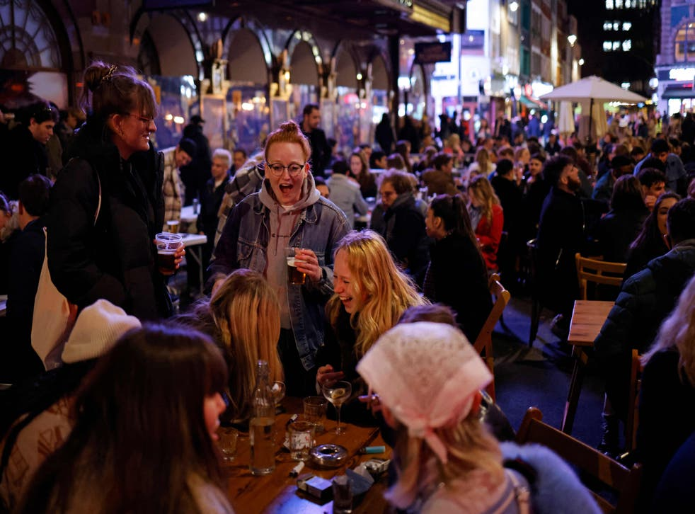Drinkers outside in Soho, London on Monday night as pubs reopened after lockdown