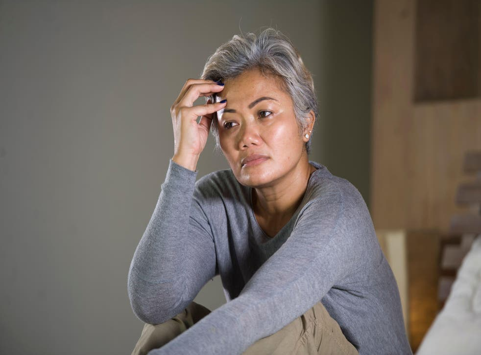 Middle-aged woman looking worried