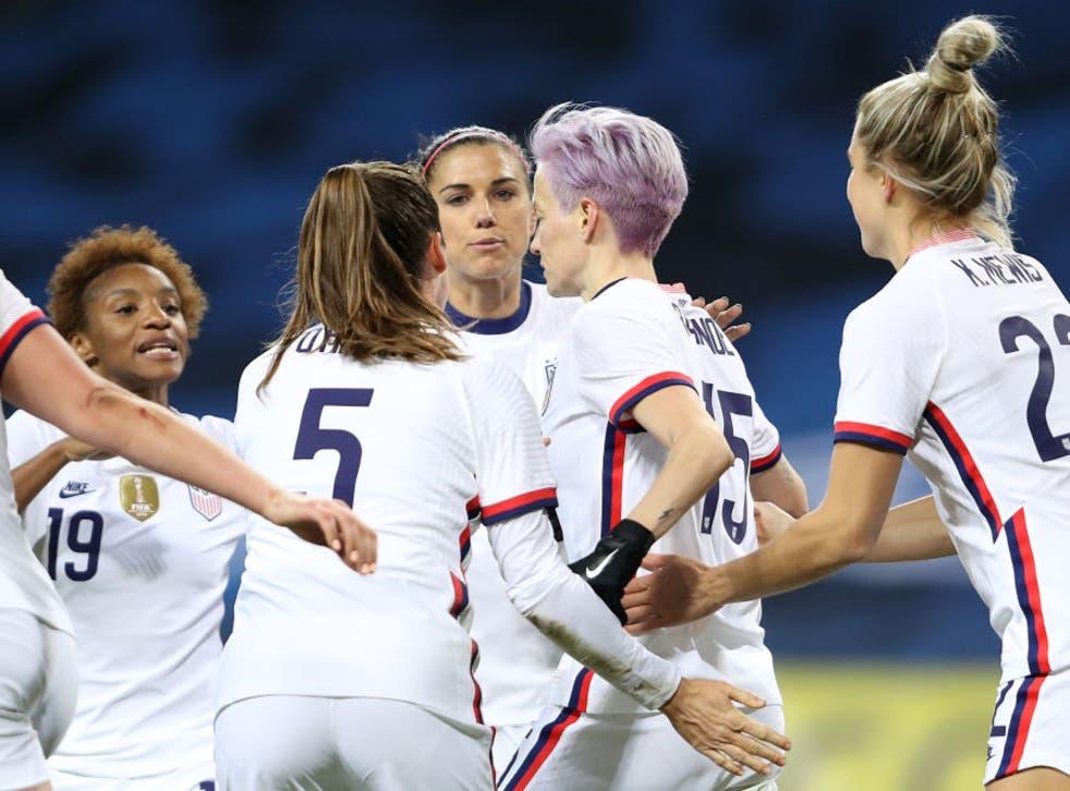 <p>Megan Rapinoe celebrates with teammates after scoring against Sweden</p>
