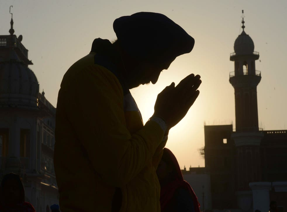 <p>The Sikh religion calls for followers to wear a turban and keep their hair long</p>
