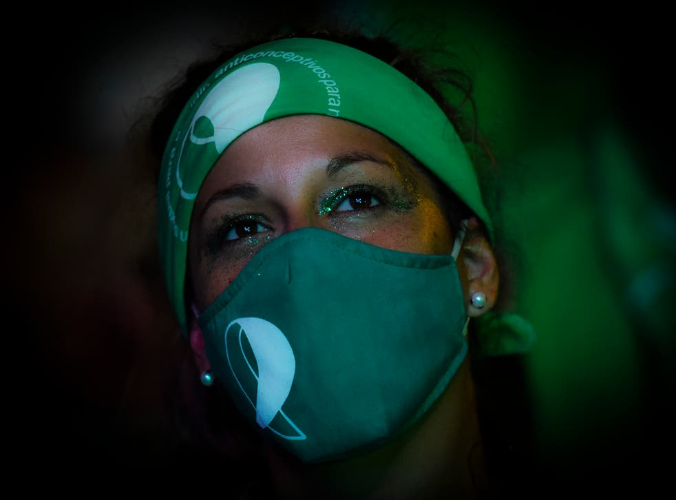 <p>Demonstrator in Buenos Aires in Argentina just before  abortion was legalised in a landmark vote in December</p>