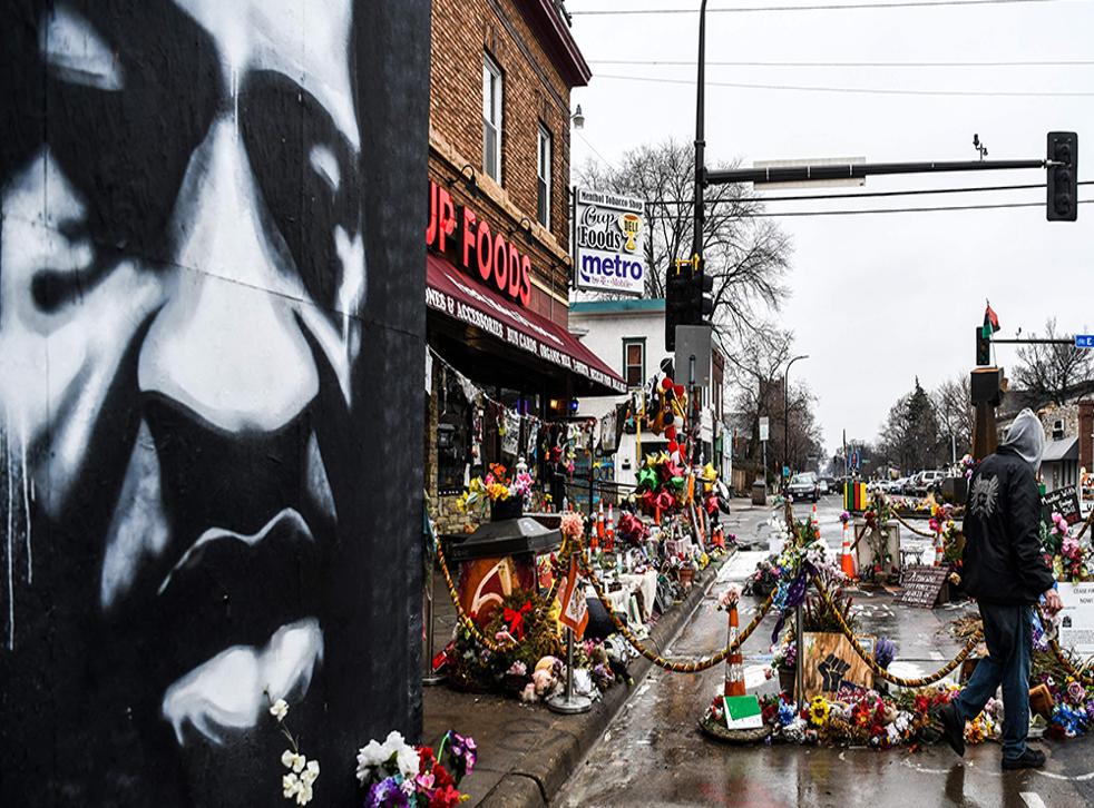 <p>Flowers laid at scene of George Floyd's death.</p>