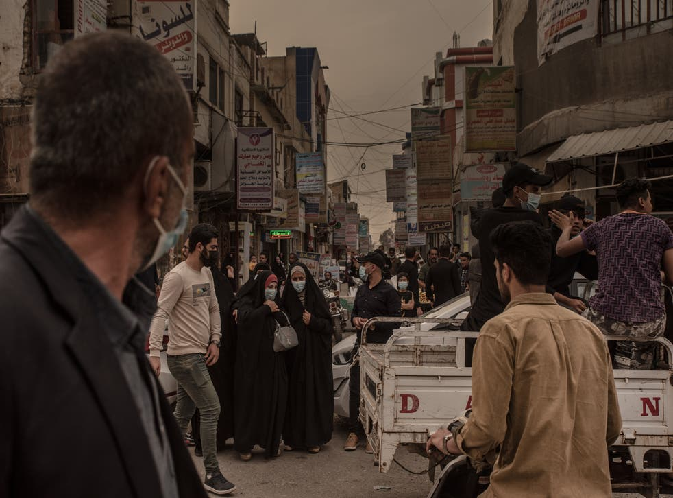 <p>A busy street in Nasiriya, Iraq, last month</p>