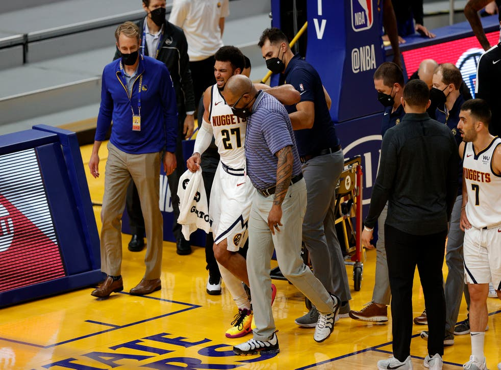 <p>Jamal Murray walked off the court following the injury</p>