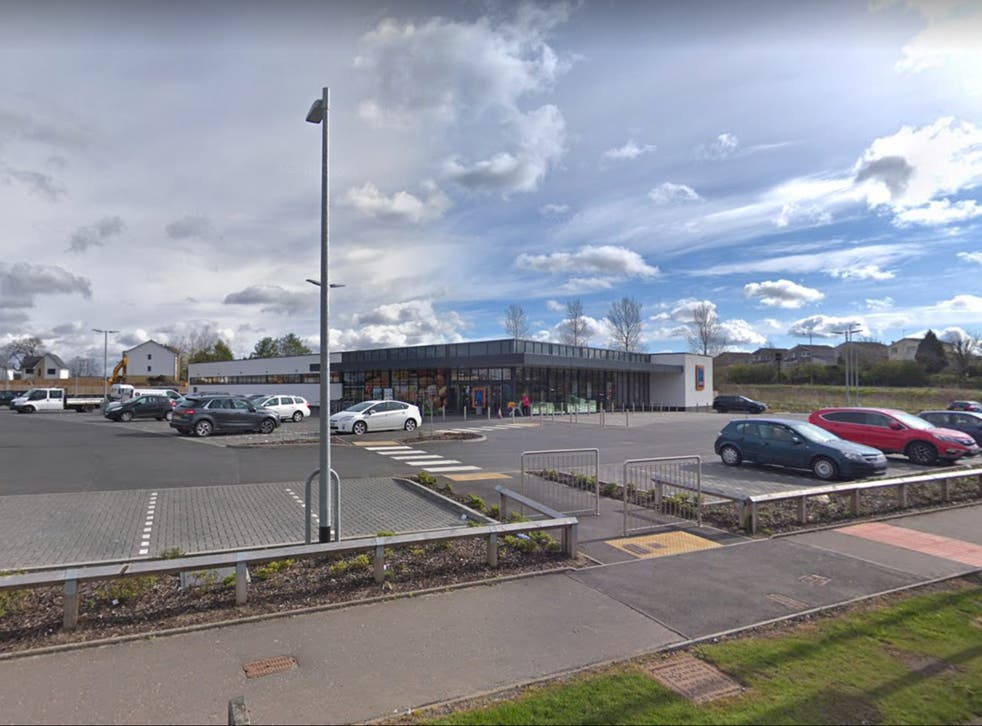 Police gathered outside the Newton Mearns branch of Aldi, seven miles southwest of Glasgow City Centre
