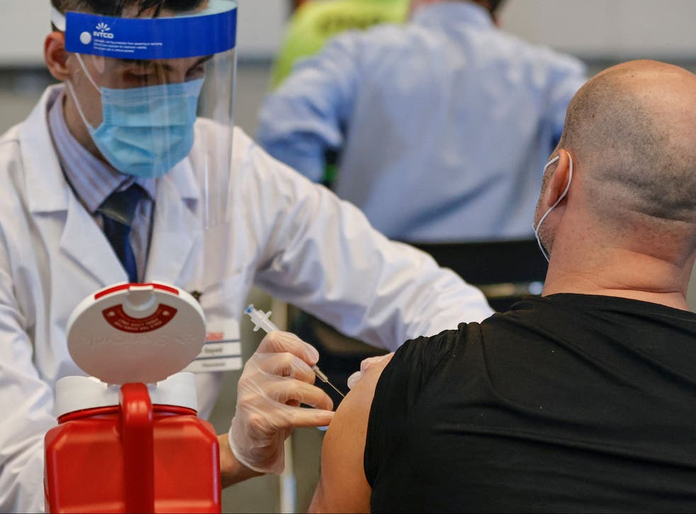 A man receives the Johnson & Johnson vaccine at a vaccination site in Chicago
