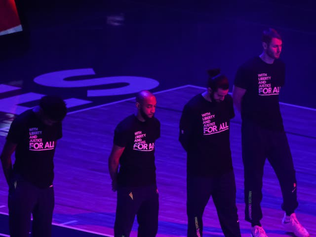 Minnesota Timberwolves players where T-shirts promoting social justice