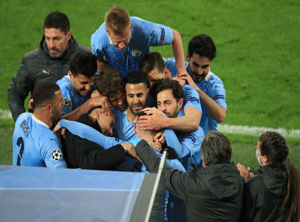 <p>Foden's teammates and manager mob him after City's second goal</p>