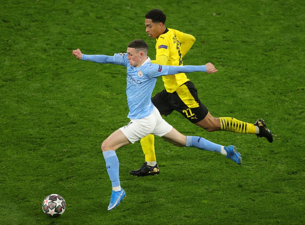 Phil Foden of Manchester City and Jude Bellingham of Borussia Dortmund