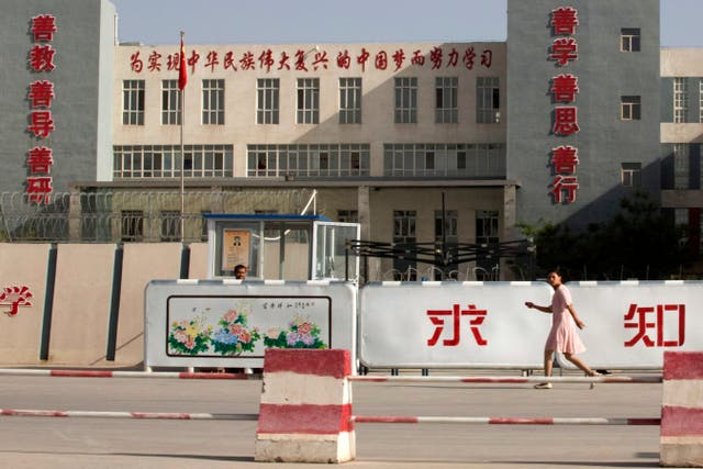 A photo from 2018 showing the Kashgar Dongcheng No. 4 Junior Middle School, which is part of a cluster of schools with slogans which read, 'Study hard to realise the Chinese dream of the great rejuvenation of the Chinese nation,' 'Kind Learning, Kind Thoughts, Kind Actions,' and 'Pursue Knowledge,' on the outskirts of in Kashgar, western China's Xinjiang region