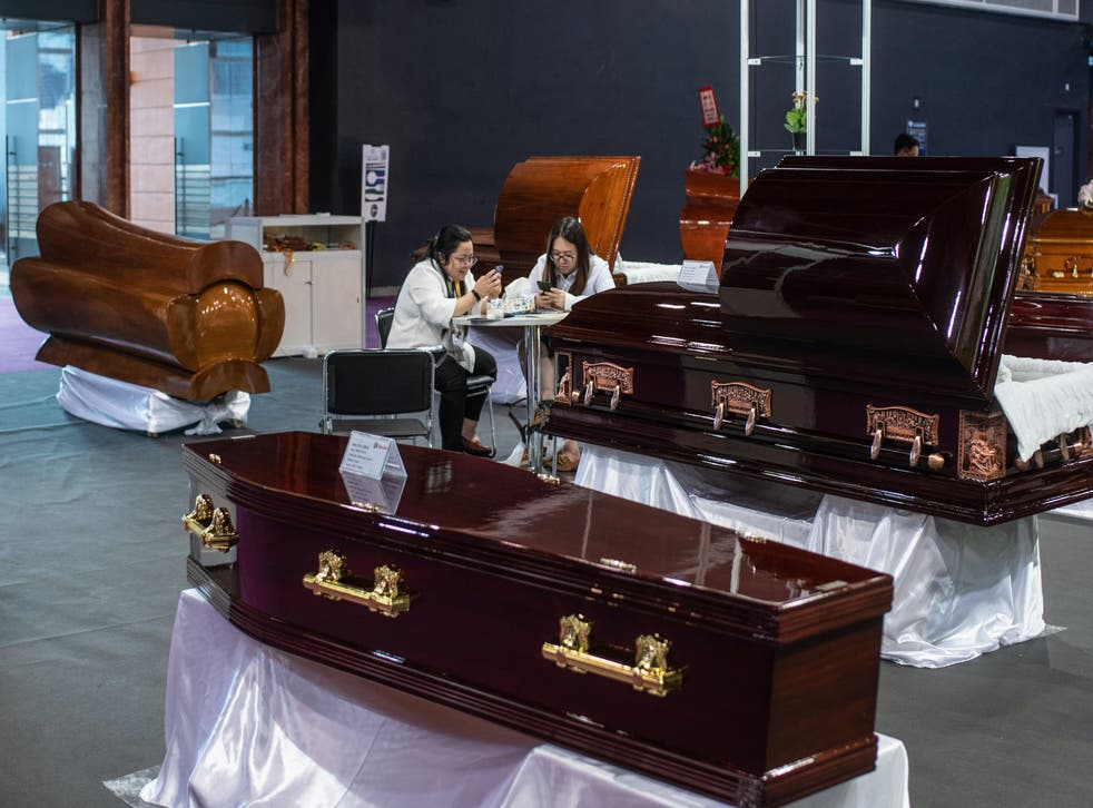 <p>Representative: Exhibitors use their mobile phones displaying caskets during the Asia Funeral and Cemetery Expo in Hong Kong on 14 May 2019</p>