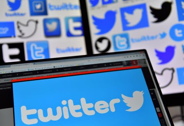 Twitter logo displayed on laptop screen