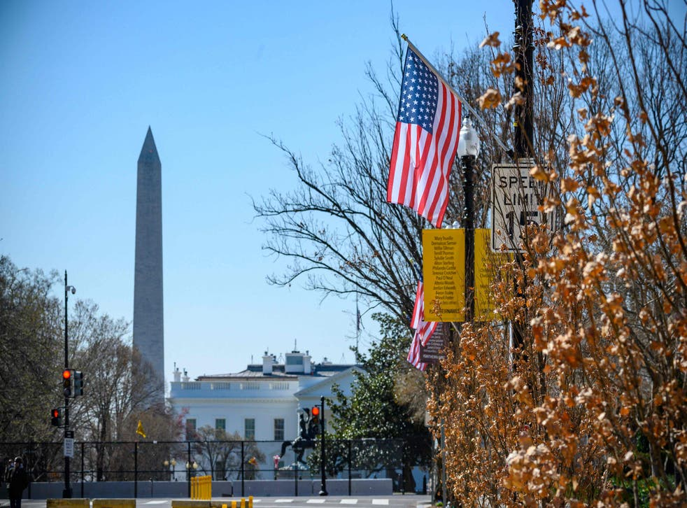 The Stars and Stripes hangs over Black Lives Matter Plaza in Washington DC –with an extra star symbolising the ambition of making the District of Columbia the 51st state of the USA