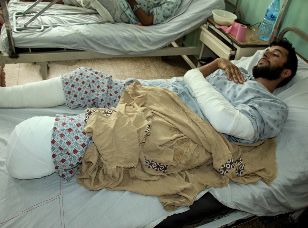 <p>An Afghan man who was injured in a bomb blast a few days ago receives medical treatment at a hospital in Arghandab district of Kandahar, Afghanistan, 15 April 2021</p>