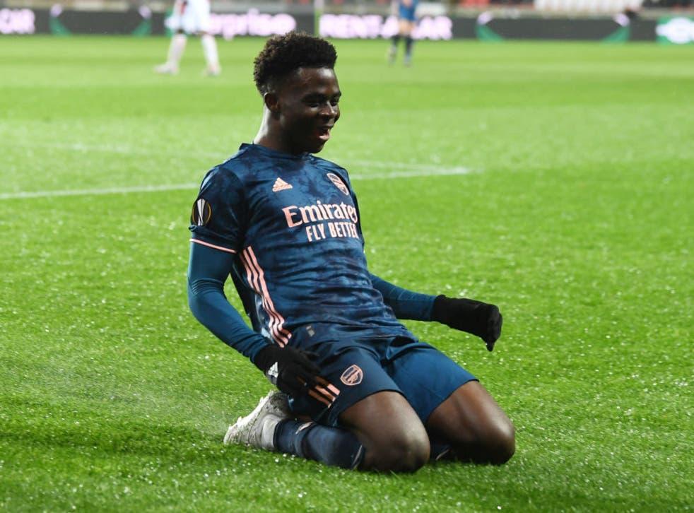 Bukayo Saka celebrates scoring against Slavia Prague