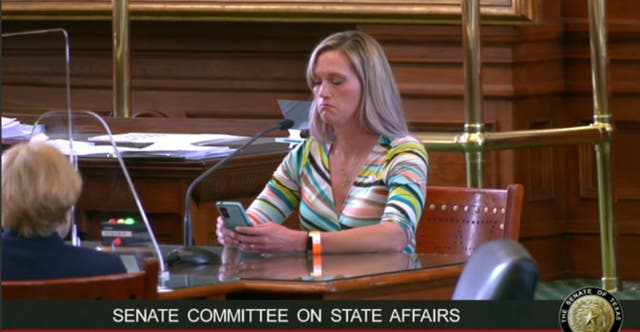 <p>Amber Briggle speaking at the Texas Senate Committee on State Affairs against four bills that would criminalise parents who support their transgender children</p>