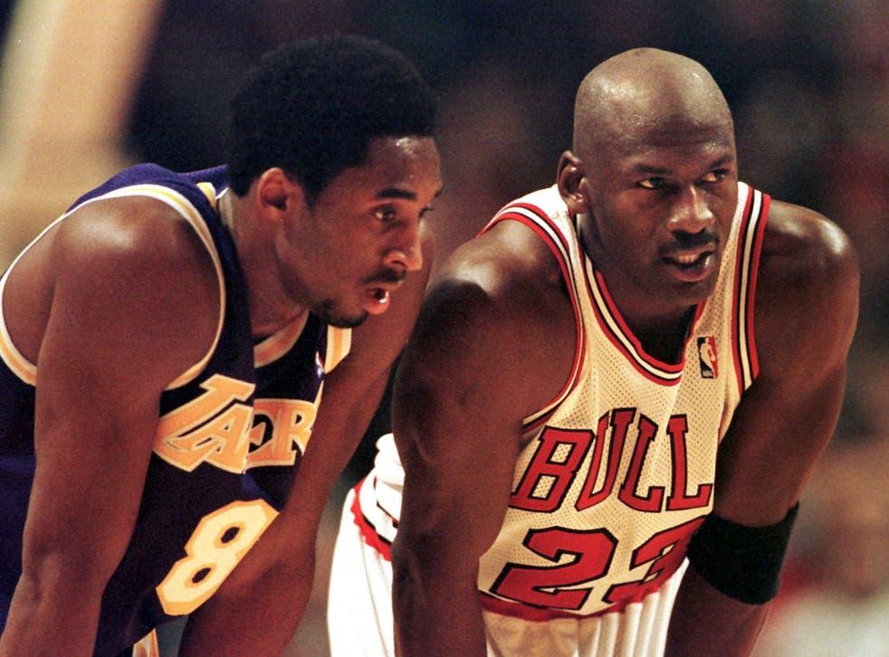 Kobe Bryant (left) on court with Michael Jordan