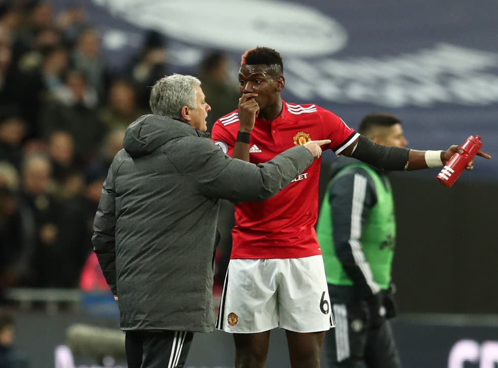 <p>Paul Pogba and Jose Mourinho speak on the touchline in 2018</p>