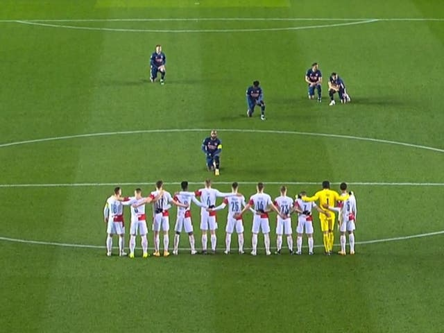Arsenal striker Alexandre Lacazette takes a knee