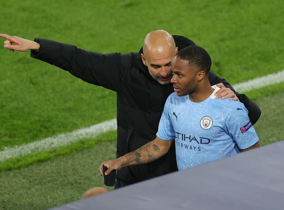 Manchester City winger Raheem Sterling with Pep Guardiola