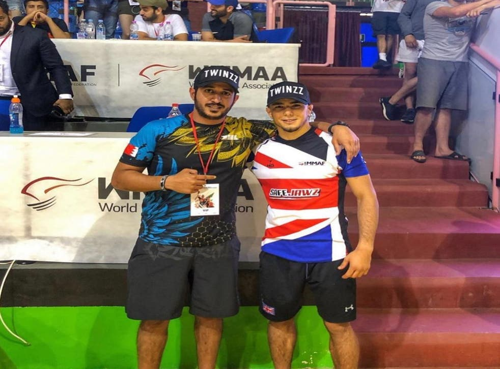 <p>Mr Mokaev (right), a six-time British wrestling champion and UK refugee, said he was struggling to focus on the sport due to the Home Office's decision</p>
