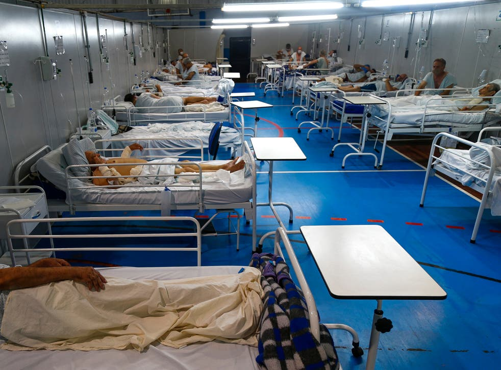 Covid patients are treated at a field hospital set up at a sports gym, in Santo Andre, Sao Paulo state, Brazil, in March