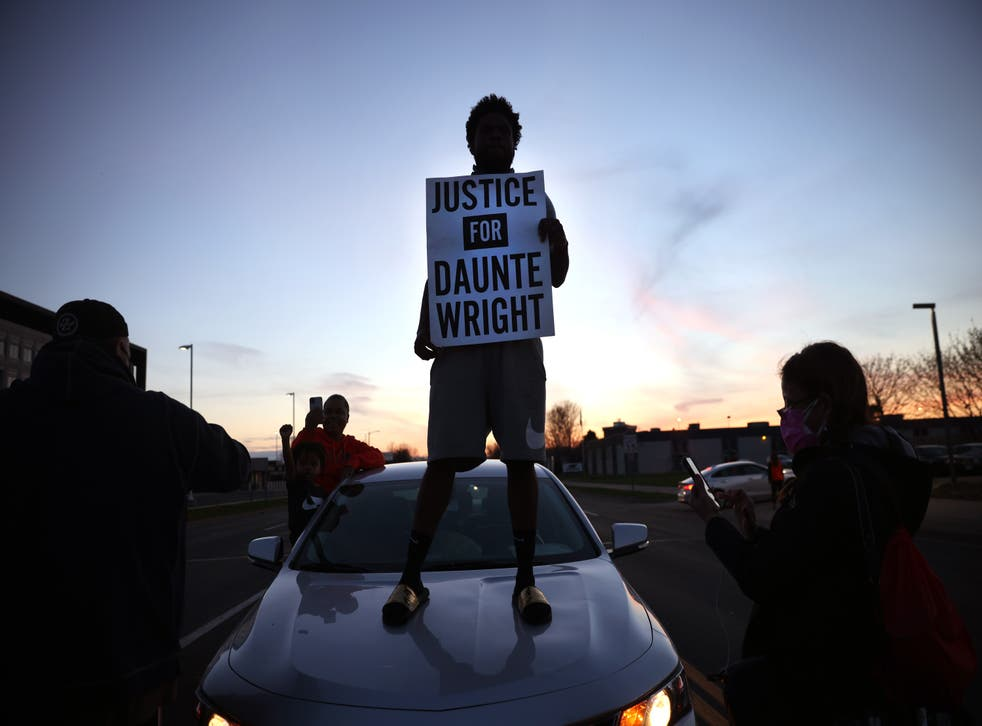 <p>Protest near the Brooklyn Center police station on 16 April  in Minnesota in the wake of the fatal shooting of 20-year-old Daunte Wright by Brooklyn Center police officer </p>
