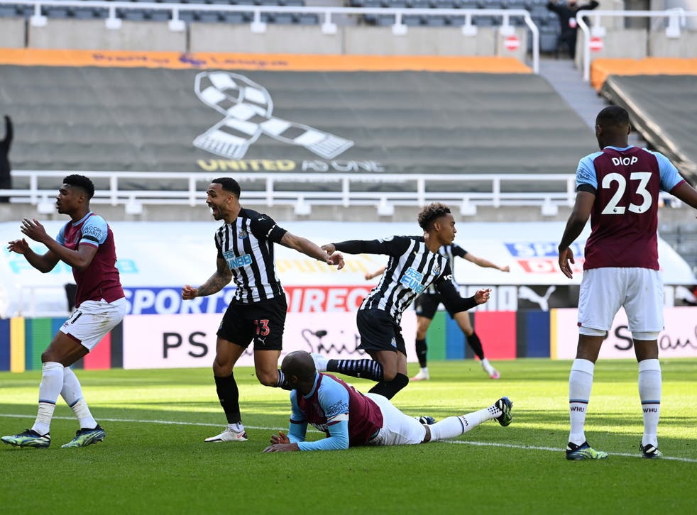 Joe Willock (centre right) celebrates his headed goal at St James' Park