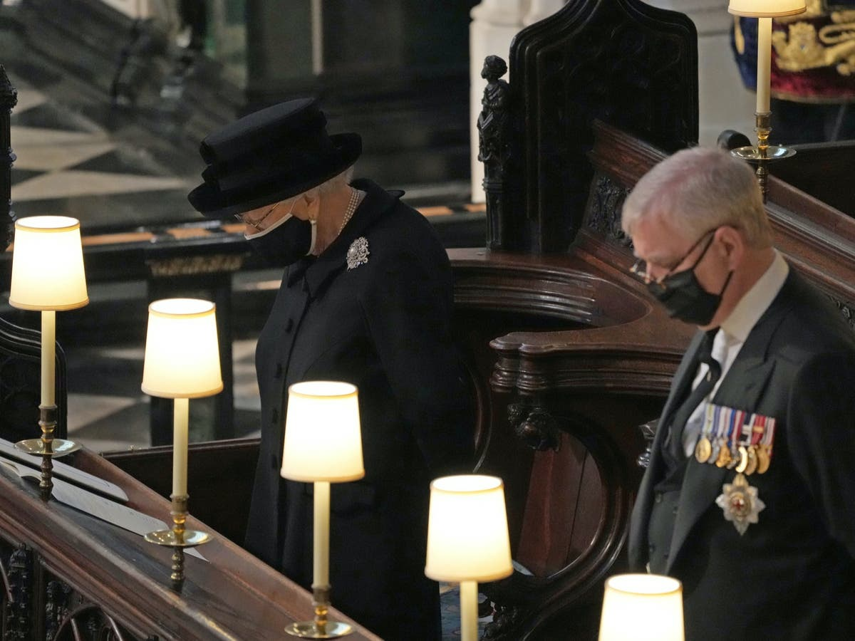 Prince Philip funeral – live: Queen leads nation in silence as William and Harry sit apart at ceremony