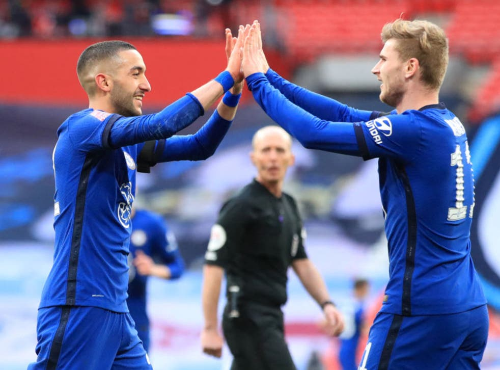 <p>Hakim Ziyech and Timo Werner celebrate at full time</p>