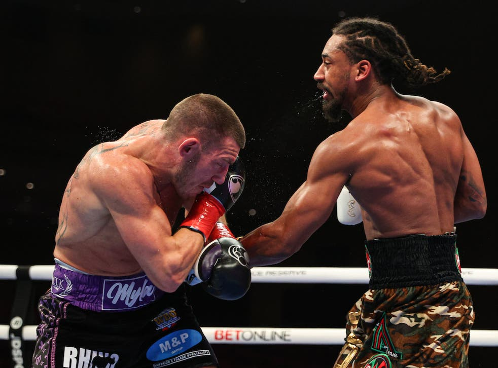 <p>Liam Williams takes a punch from Demetrius Andrade</p>