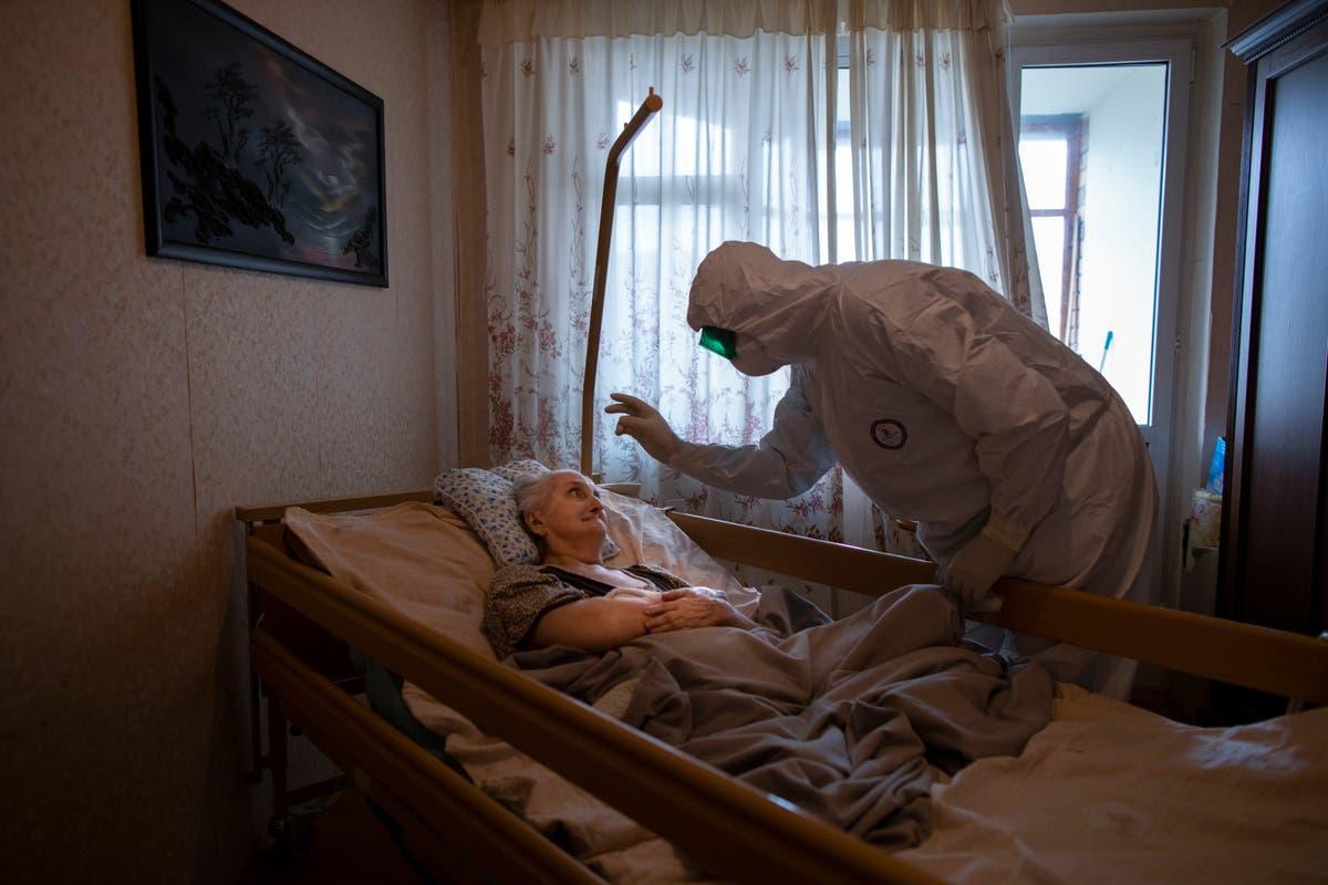 Image AP PHOTOS: Photographers reflect on single shot of pandemic