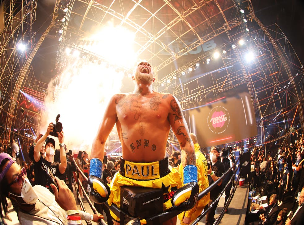 Jake Paul celebrates after clinching victory
