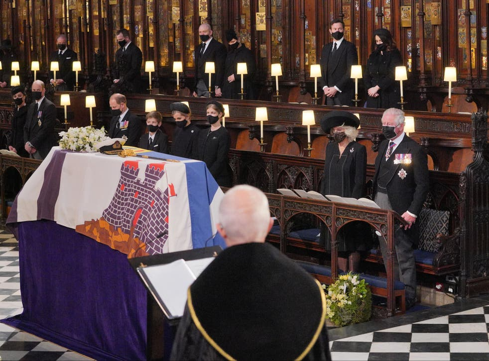 <p>Mourners, including the Duchess and Duke of Cambridge, attend the funeral of Prince Philip at St George's Chapel, Windsor Castle, on 17 April </p>