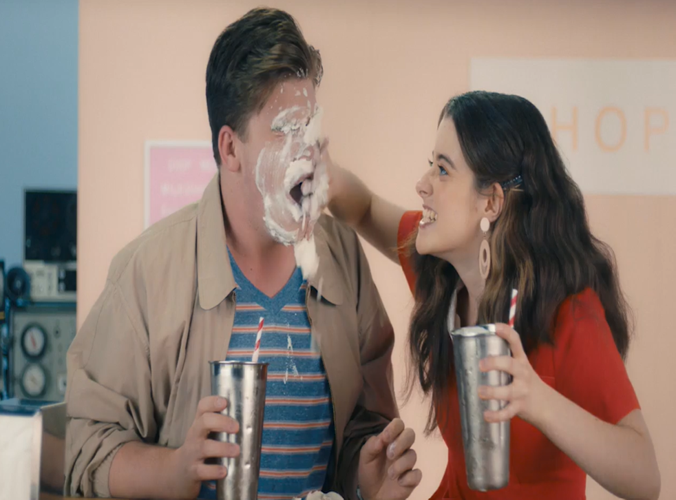 <p>A screenshot from the consent video shows a woman smearing milkshake on a man's face.</p>