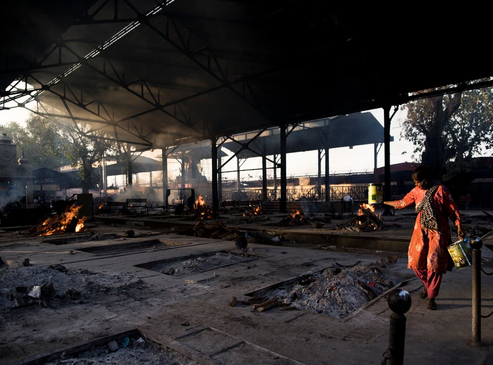 <p>Multiple burning pyres of patients who died of the Covid-19 infections at a crematorium in New Delhi</p>