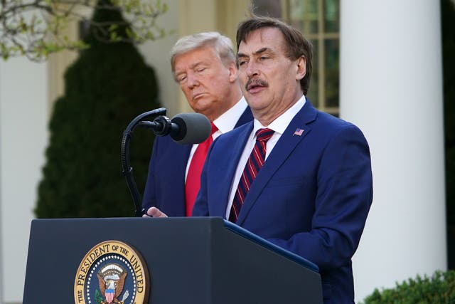 <p>US President Donald Trump listens as Michael J. Lindell, CEO of MyPillow Inc., speaks during the daily briefing on the novel coronavirus, COVID-19, in the Rose Garden of the White House in Washington, DC, on March 30, 2020. </p>